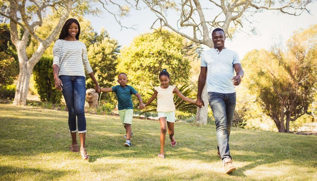 African American family enjoying their lawn.