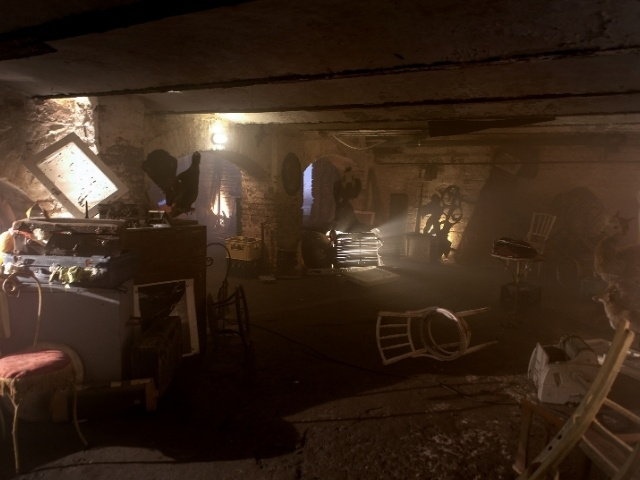 A dark and dusty basement filled with junk